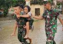 Satgas Yonif 725/Woroagi Bantu Evakuasi Banjir di Jayapura